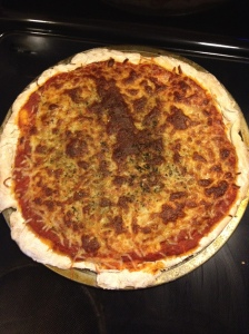 This cheese pizza has a mixture of Mozzarella and Parmesan cheese on top with other seasonings.